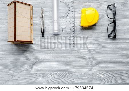 architect working desk with glasses, ruler and tools on light wooden background top view mock up