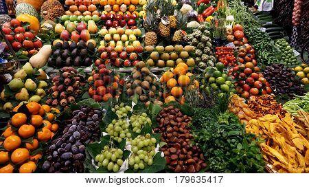 BARCELONASPAIN-FEB 182017: Fruit store at La Boqueria market next to Les Rambles in Barcelona Catalonia Spain