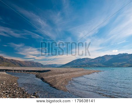Rivermouth With Pebbles And Stones