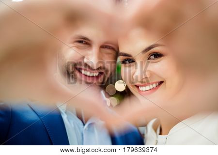 Happy Lovely Young Family Together Holding And Showing Hands In Heart Sign. Sweet Couple Falling In