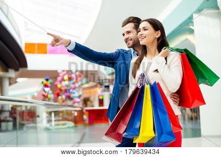 It's Shopping And Fun  Time. Cheerful  Successful Happy Young Lovely Couple In Jacket Holding  Color
