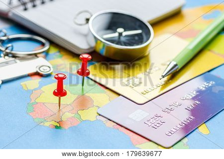 Traveling concept with car figure and credit card for online payment and on map background