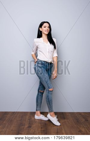 Front View, Full Portrait Of Young Cheerful Pretty Girl Holding Hand In  Pocket Of Her Jeans And Pos