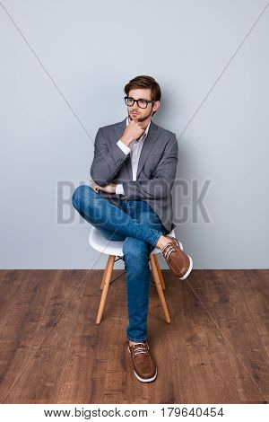 Confident Cute Smart Business Man With Spectacles In Formal Wear Sitting On The Chair