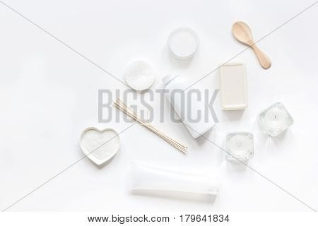 bodycare concept with white monochrome set of cosmetics for homemade spa on white woman desk background top view mock-up
