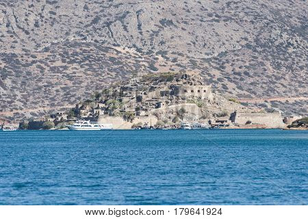 View at island of Spinalonga. Spinalonga used to be Leper colony, now it is a well known tourist destination. Crete, Greece