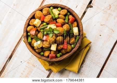 Soya chunks 65 or soya chunk fry is a healthy snack, easy to cook, protein rich, vegetarian dish ideal for starters. popular indian food. selective focus poster