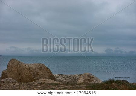 Classic autumn picture of caspian sea with montains rocks and Gloomy blue sky Baku Azerbaijan