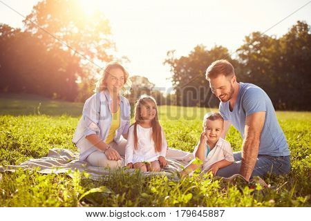 Family with children on picnic in park