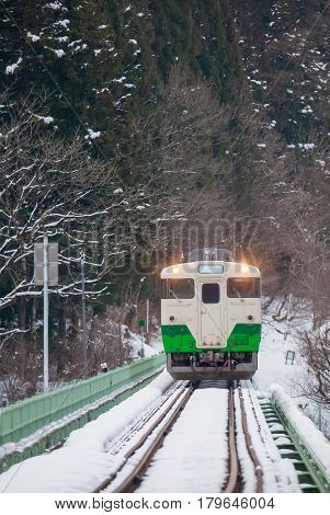 Japan mountain and snow with local train in winter season at Mishima town Fukushima prefecture
