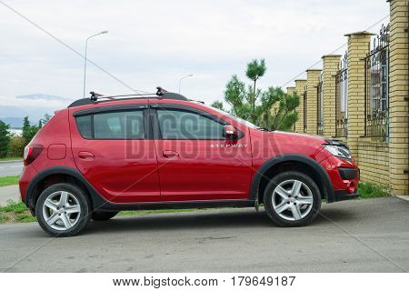 Sochi, Russia - October 11, 2016: New Renault Sandero Stepway parked on the country road.