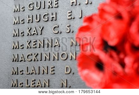 Canberra Australia - March 18 2017. Poppy wall lists the names of all the Australians who died in service of armies. The red poppy has become a symbol of war remembrance (ANZAC Day) the world over.