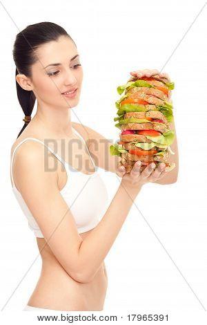 Woman Eating A Big Sandwich