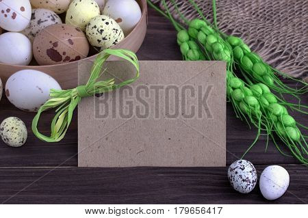 Easter Eggs With Burlap Cloth Green Spikelets Green Ribbon And Space For Text.