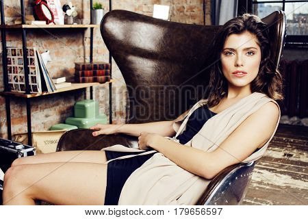 young pretty woman waiting alone in modern loft studio, fashion musician concept, lifestyle people close up