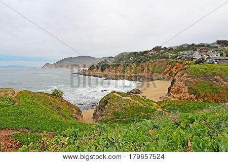 MONTARA CALIFORNIA - MARCH 16 2015: Houses on cliffs overlooking Montara State Beach off of California Highway 1 approximately 25 miles south of San Francisco on a cloudy day.