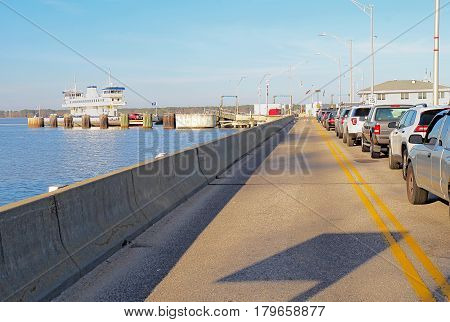 SCOTLAND VIRGINIA - FEBRUARY 20 2017: Cars waiting in line for the Jamestown-Scotland Ferry between Jamestown Island and Surrey in Virginia. This historic car ferry has been in operation since 1925.