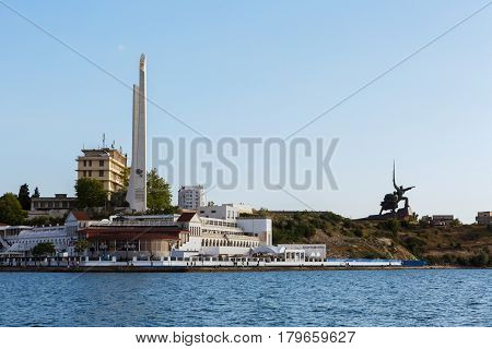 Sevastopol, Russia - June 09, 2016: Stella Shtyk and Sail with the text about awarding the city of Sevastopol the title of Hero City and the monument of Soldier and Sailor