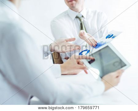 closeup of business team using digital tablet, working with the financial schedule of the company's development