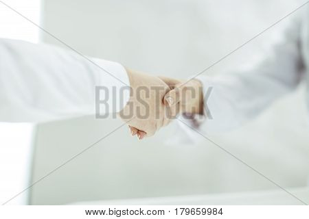 handshake Manager and client on a background of bright office .the photo has a empty space for your text