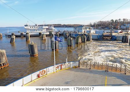 SCOTLAND VIRGINIA - FEBRUARY 20 2017: Ferry boat leaving the Jamestown-Scotland Ferry docks on its run between Jamestown Island and Surrey. This historic car ferry has been in operation since 1925.
