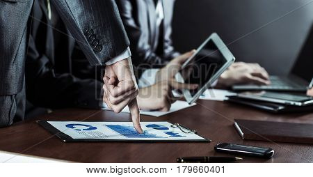 business team with digital tablet and financial charts for the workplace in the office.the photo has a empty space for your text