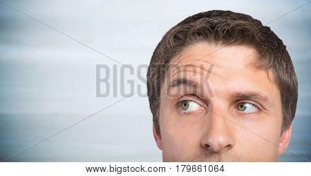 Digital composite of Top of man's head against blurry grey wood panel