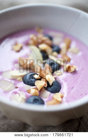 Smoothie bowl with blueberries and almond