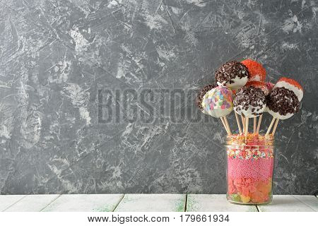Various cake pops decorated with white chocolate
