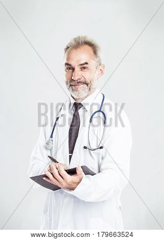 therapist with a stethoscope on light background. the photo has a empty space for your text