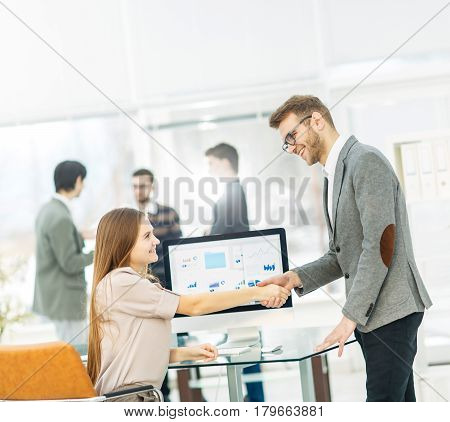 handshake between lawyer and client after reviewing the investment plan for development of the company.the photo has a empty space for your text.