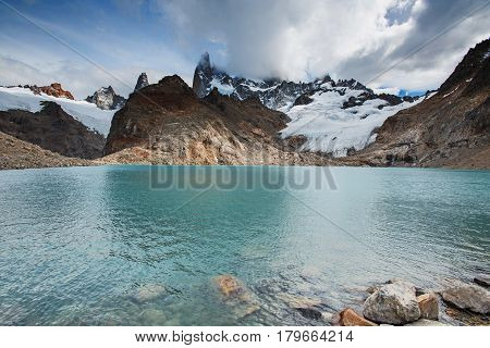 Laguna de Los Tres at base of Mount Fitz Roy in Patagonia in Argentina on a cloudy day