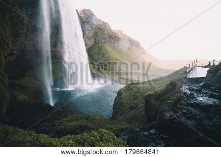 Perfect view of famous powerful Seljalandsfoss waterfall in sunlight. Dramatic and gorgeous scene. Location place Iceland, sightseeing Europe. Instagram effect. Discover the world of beauty.