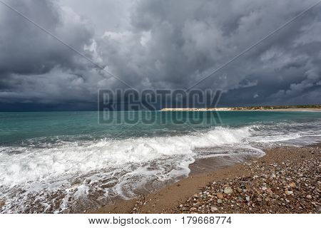 Sea beach before the storm: wind and clouds