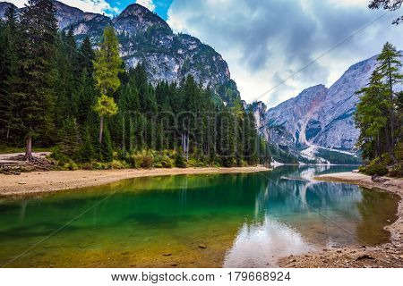 Travel to Tirol, Italy. Walk around the picturesque lake Lago di Braies. The concept of walking and eco-tourism