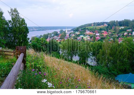 View from above on quiet provincial town of Ples and Volga River in summer twilight Russia