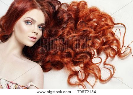 Sexy nude beautiful redhead girl with long hair. Perfect woman portrait on light background. Gorgeous hair and deep eyes. Natural beauty clean skin facial care and hair. Strong and thick hair