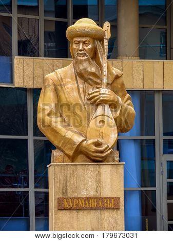 ALMATY KAZAKHSTAN - MARCH 26 2017: Bust of Kurmangazy opposite the Kazakh National Conservatory in Almaty Kazakhstan. Was a Kazkh composer instrumentalist and folk artist.