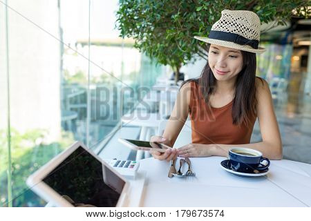 Woman pay with cellphone by NFC in restaurant