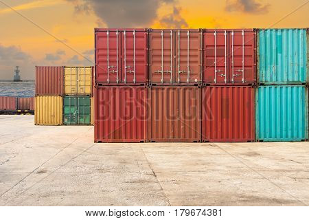 Handling stack of container shipping on twilight scene.