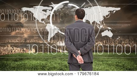 Digital composite of Businessman looking at City with world map interface