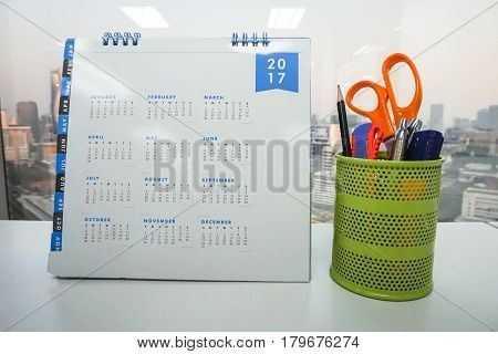 2017 calendar on office table with stationary in green box