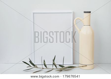 Frame mockup on white background ceramic bottle olive tree branch clean minimalist styled image for social image marketing blogging