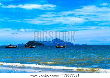 The long tail boat with blue sky and nice sea.