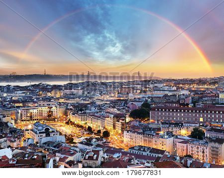 Lisbon with rainbow in Lisboa cityscape Portugal