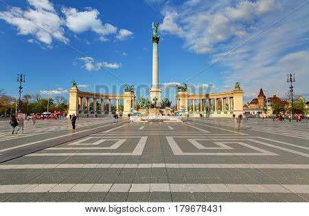 BUDAPEST - APRIL 18 2015: Tourists visit Millennium Monument in Heroes Square in Budapest Hungary. This square has been UNESCO World Heritage site since 2002.