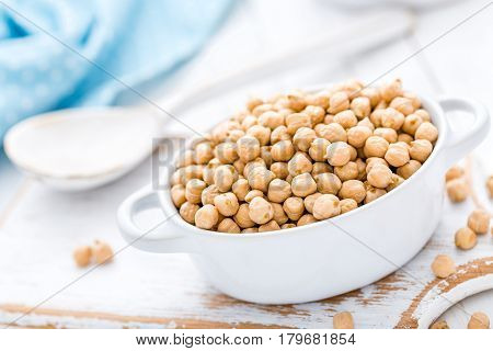 Chickpea on white rustic background close up