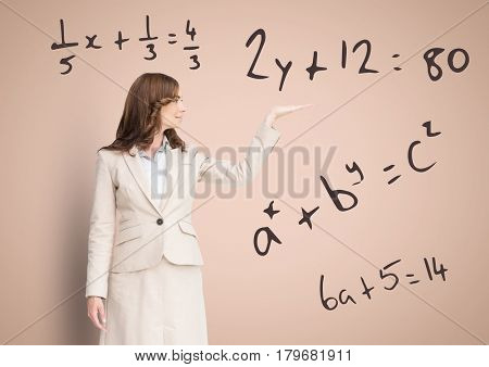 Digital composite of Woman with open palm hand with math equations
