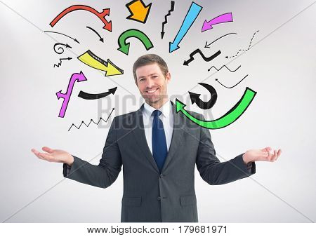 Digital composite of Man choosing or deciding with open palm hands and many colourful arrows around him