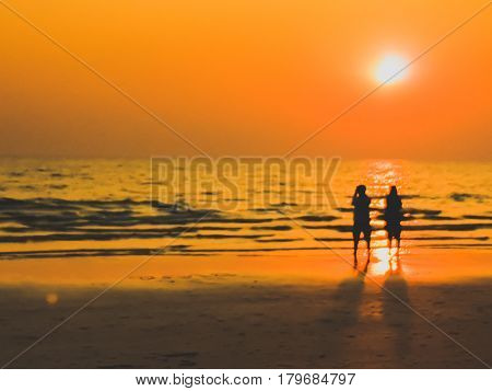 Burry In A Dream Frame Man And Woman Sight Seeing On The Beach With Sunset